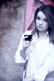 Beautiful girl in white shirt with red wine Royalty Free Stock Photo
