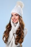 Beautiful girl in white sweater Stock Images