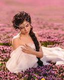 A beautiful girl  in a white vintage dress Royalty Free Stock Image