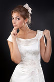 Beautiful girl in a white wedding dress Stock Photography