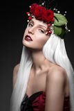 Beautiful girl in white wig, red roses, delicate Stock Images