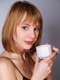 Beautiful girl whith a cup of tea or coffe Royalty Free Stock Image