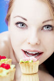 Beautiful girl who eats cakes Royalty Free Stock Photography