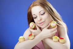 Beautiful girl who eats cakes Stock Photo