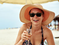 Beautiful girl in wide-brimmed hat drinking champagne Royalty Free Stock Photo
