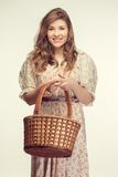 Beautiful girl wiht basket Stock Image
