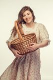 Beautiful girl wiht basket Royalty Free Stock Images