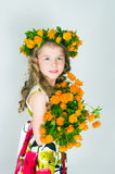Beautiful girl and wild flowers Royalty Free Stock Photography