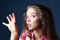 Beautiful girl with wild hair scares Stock Photo