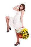 Beautiful girl with wild yellow spring flower. Stock Photography
