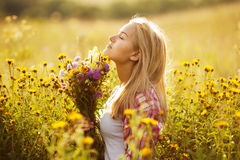 Beautiful girl among the wildflowers in summer Stock Image