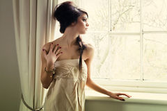 Beautiful girl by window royalty free stock photo
