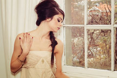 Beautiful girl by window stock image