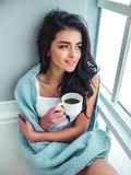 Beautiful girl on a window sill Stock Photo