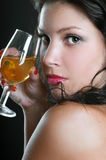 Beautiful girl with wine glass on black Royalty Free Stock Photography