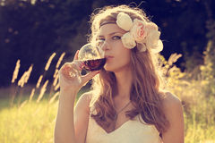 Beautiful girl with wine at sunset Stock Images