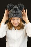 Beautiful girl with winter bear hat Royalty Free Stock Image