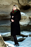 Beautiful girl in winter Christmas photo shoot at the park Royalty Free Stock Photos