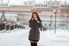 Beautiful girl in winter city Stock Image
