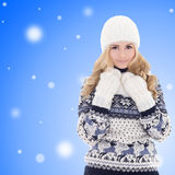 Beautiful girl in winter clothes over winter background Royalty Free Stock Photography