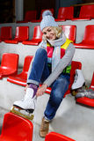 Beautiful girl in winter clothes with skates Stock Photography