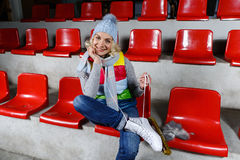 Beautiful girl in winter clothes with skates Stock Photos