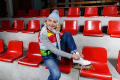 Beautiful girl in winter clothes with skates Stock Images