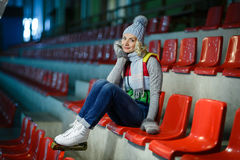 Beautiful girl in winter clothes and skates Stock Photography