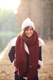 Beautiful girl in winter clothes smiling with sunset Royalty Free Stock Images