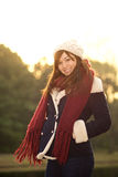 Beautiful girl in winter clothes smiling with sunset Stock Image