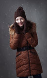 Beautiful girl in winter clothes with snow Royalty Free Stock Images