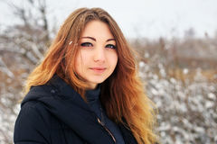 Beautiful girl in the winter in cold snowy forest Royalty Free Stock Image