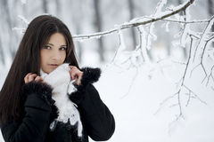 Beautiful girl in winter forest Royalty Free Stock Photos