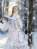 Beautiful girl in a winter forest Royalty Free Stock Image
