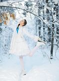 Beautiful girl in a winter forest Royalty Free Stock Photo