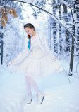 Beautiful girl in a winter forest Royalty Free Stock Photos