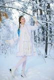 Beautiful girl in a winter forest Royalty Free Stock Images