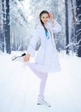Beautiful girl in a winter forest Stock Images