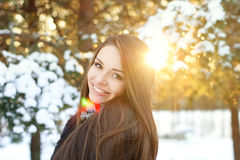 Beautiful girl in winter forest. Young beatiful smiling girl portrait in winter forest Royalty Free Stock Photo
