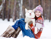 Beautiful girl in winter forest with dog Royalty Free Stock Photos