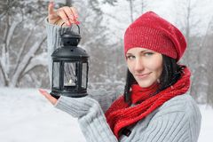 Beautiful girl in winter forest with lantern Royalty Free Stock Images