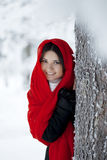Beautiful girl in winter forest in red Royalty Free Stock Photos