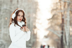 Beautiful girl in winter forest Royalty Free Stock Photography