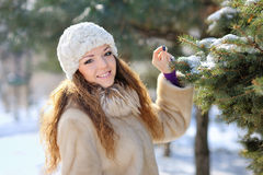 Beautiful girl in winter hat walks Royalty Free Stock Image