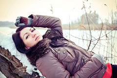 Beautiful girl by winter lake Royalty Free Stock Images