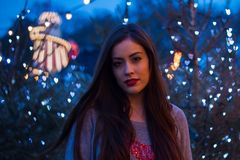 Beautiful girl in the winter outdoors. Christmas. Shallow depth Royalty Free Stock Photos