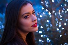 Beautiful girl in the winter outdoors. Christmas. Shallow depth Royalty Free Stock Photography