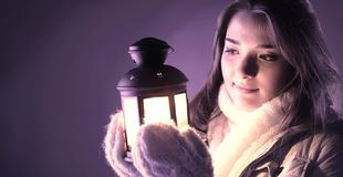 Beautiful girl on winter snow. Beautiful girl with lantern on winter snow stock image