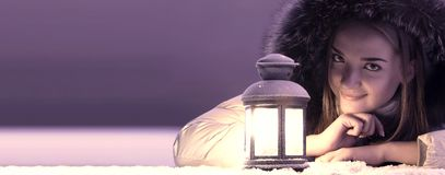 Beautiful girl on winter snow. Beautiful girl with lantern on winter snow stock images