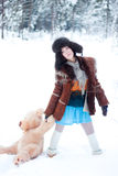 Beautiful girl on winter snowy forest background with teddy bear Royalty Free Stock Image
